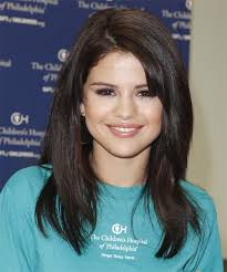brunette hairstyles wiyh swept away bangs selena gomez long straight casual hairstyle with side swept bangs