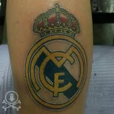 acm soccer logo mens torn skin tattoo on arms soccer tats