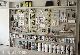 organizing the garage with diy pegboard storage wall diy garage pegboard storage wall using only 5 5 inches in depth the creativity exchange