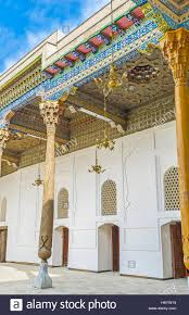 the mix of carved and painted wooden decor in exterior of sheikh