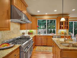 what color backsplash with honey oak cabinets giallo ornamental granite countertops pictures cost pros
