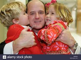 miami florida office christmas party father children hug kiss