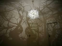 tree chandelier a chandelier that projects tree shadows colossal