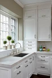 white shaker kitchen cabinets to ceiling crisp white shaker cabinets go to the ceiling in this white