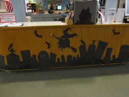 front of circulation desk decorated for halloween use black