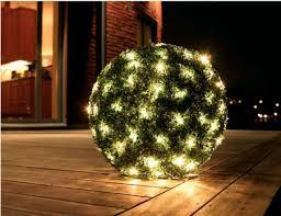 outdoor christmas lights for bushes christmas decorating ideas using baskets christmas bush lights