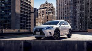 white lexus 2018 white car lexus nx 300h 2018 on the background of houses