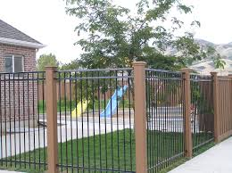 semi private fencing with iron panels and trex posts trex