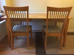 light wood dining table and six chairs with metal accents and off