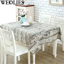 cheap tablecloth rentals wood table cloth checkered tablecloth on wooden stock photo