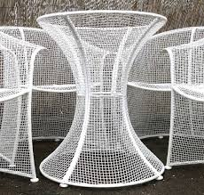 woodard mid century wrought iron patio table and four chairs