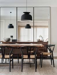 dining room with black wishbone chairs and gubi u0027rode u0027 pendant