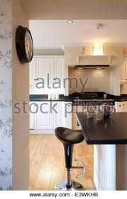 black range oven in country kitchen with fitted oak units stock