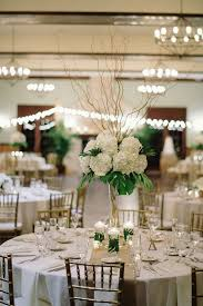 curly willow centerpieces ivory hydrangea palm leaf and curly willow centerpieces