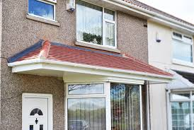 beautiful large tiled canopy above a bay window and front door