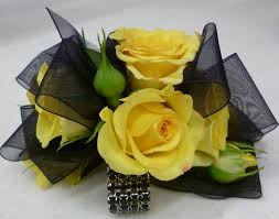 and black corsage black rock candy corsage with yellow roses grande flowers