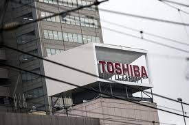 toshiba auction of chip unit is slowed by dispute with u s