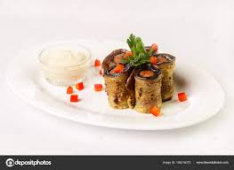 second en cuisine second dish of eggplant rolls with and sauce on white plate