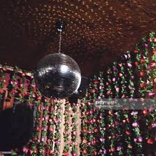 low angle view disco ball hanging on ceiling against