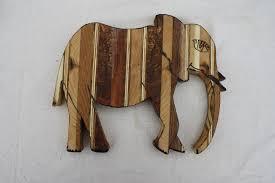 custom reclaimed wood animals by honeybadger woodworks llc