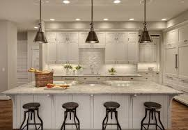cool track lighting installation above the kitchen island hudson valley lighting