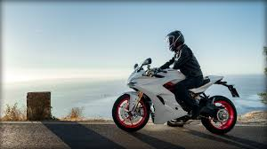 2017 ducati supersport s wallpapers photos of the 939 supersport s riding on twisty roads ducati