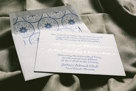 wedding invitations with island inspired envelope liner