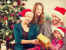 family with opening gifts stock photo