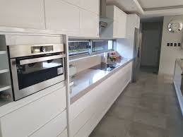 white gloss kitchen cupboard wrap choosing a white high gloss finish simply cabinet doors