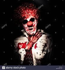 halloween portrait background evil spooky clown portrait on black background stock photo