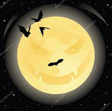 evil halloween smiling face on the moon in the night sky full of