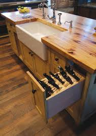 butcher block island with porcelain sink and knive storage pull