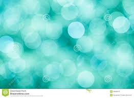 blue green and turquoise background with bokeh defocused lights
