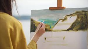 A Creative Woman Paints A Painting With Oil Paints On Canvas