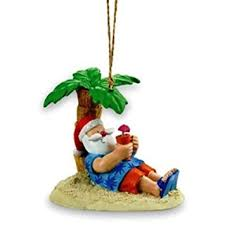 santa relaxing a palm tree