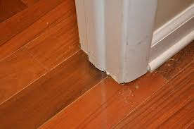 cut door trim and stops for hardwood flooring installation in