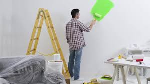Preparation For Painting Interior Walls Professional Painter Preparing A Room For Painting He Is Covering