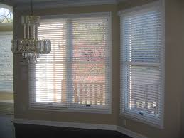 faux wood blinds for your new home windo van go