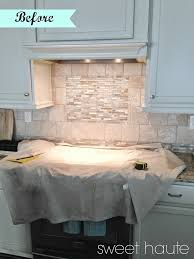 stone tile diy backsplash frame tutorial sweethaute