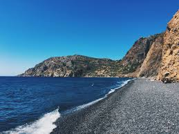 Black Sand Beaches by The Black Sand Beach Of Emporios On The Island Of Chios Greece
