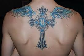 fussy cross with a letter and wings on back wf