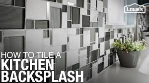how to cut tile around cabinets installing a tile backsplash