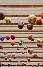 colorful christmas decorations hanging from ceiling u2014 stock photo