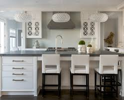 white kitchen cabinets black appliances transitional with bling
