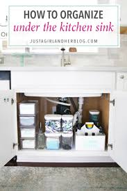 How To Organize A Kitchen Cabinet - how to organize under the kitchen sink just a and her blog