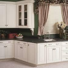 interior design white kitchen cabinet with black countertop