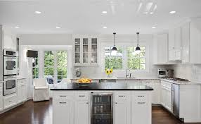 white kitchen cabinets with black quartz quartz vs granite which is best all about countertops