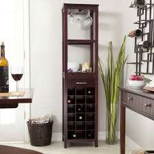 tall wooden wine cabinet rack with upside down glass holder atop