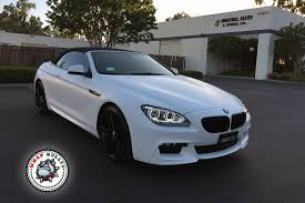 custom white bmw bmw m6 wrapped in satin white wrap bullys