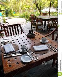 Backyard Dining by Outdoor Dining Restaurant Table Cutlery Settings Stock Photos